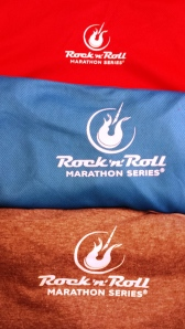common logo on the backs of all three t-shirts